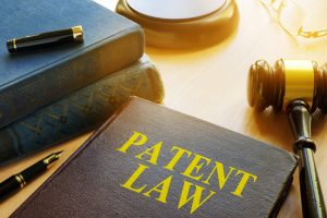 Book about Patent Law and gavel. Copyright concept.